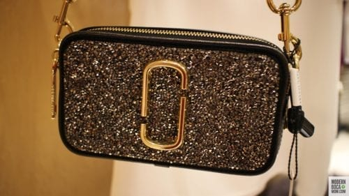 Not brave enough for the dress? Snag a sequin camera bag!